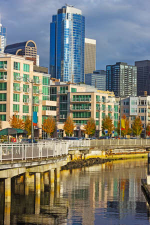 puget sound: Seattle downtown near waterfront in the late autumn afternoon. Building reflections in waters of Puget Sound. Stock Photo