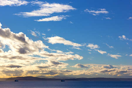 puget sound: Sunset over Puget Sound in Seattle, Washington. Waters of Puget Sound and mountains chain on a horizon.