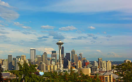mount rainier: Seattle city skyline with Mount Rainier on background in summer. Seattle city panorama and Mount Rainier with a snow top. Stock Photo