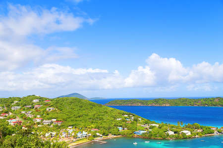 vi: Arial view of St Thomas Island near Coki Beach, US VI. Motorboats at the sea near the tropical island. Stock Photo
