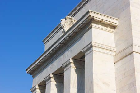 Federal Reserve building in Washington DC, US. The eagle on the front facade of the Eccles Building in the morning. Archivio Fotografico