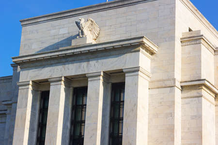 Federal Reserve building in Washington DC, US. Facade of the building with eagle statue in the morning. Stock Photo