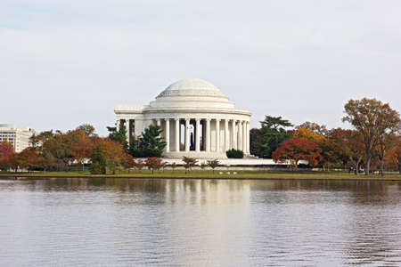 jefferson: Autumn colored trees around Thomas Jefferson Memorial and Tidal Basin in Washington DC, USA. Scenic view on the Tidal Basin and Jefferson Memorial in fall.