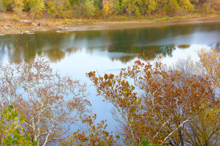 river banks: A view on Potomac River banks in autumn. Sunset near Potomac River in Washington DC. Stock Photo