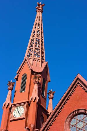 calvary: A historic clock tower of Calvary Baptist Church Washington DC. The church tower lit by evening sun. Stock Photo