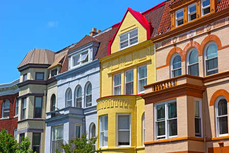 Row houses on a sunny spring day in Washington DC USA. Historic townhouse architecture of US capital. Фото со стока