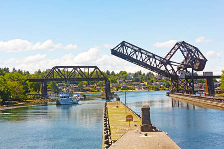puget: Ballard Locks on a summer day in Seattle. Locks connect the waters of Puget Sound with freshwater of Lake Union and lake Washington. Stock Photo
