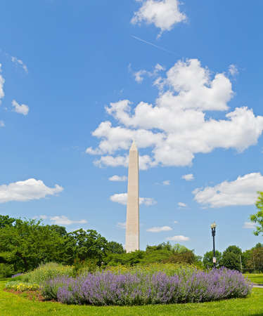 washington monument: Washington Monument on Memorial Day weekend. Washington Monument against a cloudy blue sky.