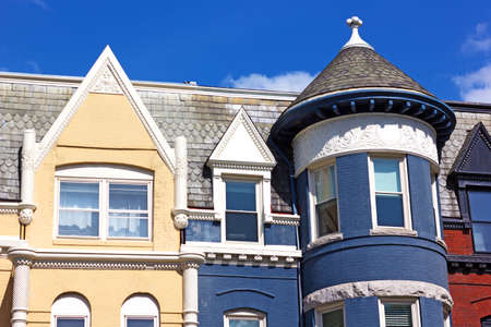 Details of residential architecture of Washington DC, USA. Colorful townhouses close up at Dupont Circle neighborhood in Washington DC. Stock Photo