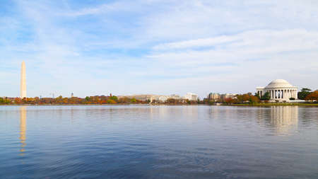 Washington Monument and Thomas Jefferson Memorial in the Fall. Panoramic view of the Tidal Basin with major national capital attractions surrounded by the colorful tree foliage in the Fall.