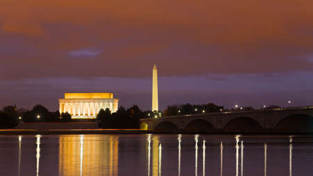 lincoln memorial: Washington Monument, Lincoln Memorial and Arlington Memorial Bridge at night. Illuminated major national capital attractions with light reflections in the Potomac river. Editorial