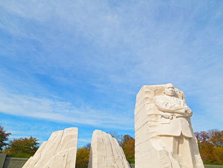 WASHINGTON DC - NOVEMBER 09, 2014: The Martin Luther King Jr Memorial and the National Monument on the National Mall in Washington DC in the Fall. The Memorial near the Tidal Basin is located on a sightline linking the Lincoln Memorial and the Jefferson M Редакционное