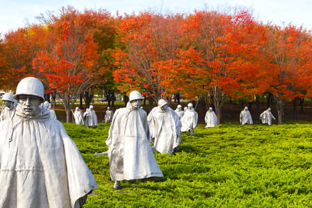 WASHINGTON DC - NOVEMBER 09, 2014: Korean War Veterans Memorial on the National Mall in Washington DC. The bright colors of autumn emphasize the dramatic expression of The Memorial.