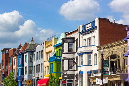 adams: WASHINGTON DC, USA  - MAY 9, 2015: Row houses in Adams Morgan neighborhood on May 9, 2015 in Washington DC. Sunny spring day on the street of a vibrant city neighborhood.