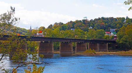 west river: Railway bridge over Shenandoah River at Harpers Ferry in West Virginia. USA. Harpers Ferry historic town in autumn along Blue Ridge Mountains. Stock Photo