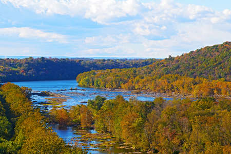 west virginia trees: View on Shenandoah River and Blue Ridge mountains from Harpers Ferry overlook. Blue river and autumn trees foliage on a bright afternoon, West Virginia, USA.