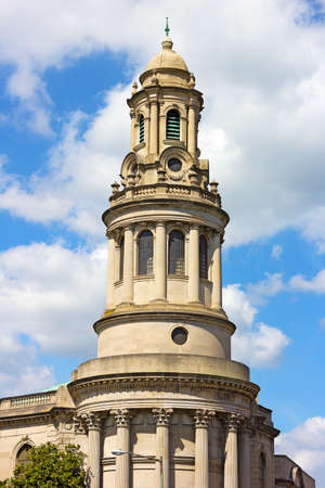 The National Baptist Memorial Church in Washington DC, USA. The church top against a cloudy blue sky.