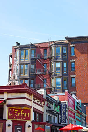 adams: WASHINGTON DC, USA  MAY 9, 2015: Street with restaurants and clubs in Adams Morgan neighborhood on May 9, 2015 in Washington DC. At the street corner LEnfant caf bar offers European charm and friendly service. Editorial