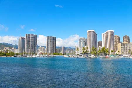 honolulu: Honolulu in an early morning, Hawaii. Yachts and buildings near the water in Honolulu, Hawaii.