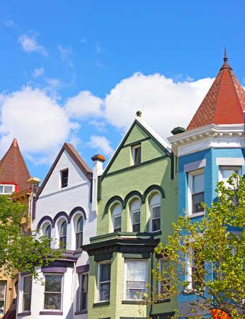 row of houses: Historic architecture of Washington DC, USA. Colorful residential row houses under bright afternoon sun.