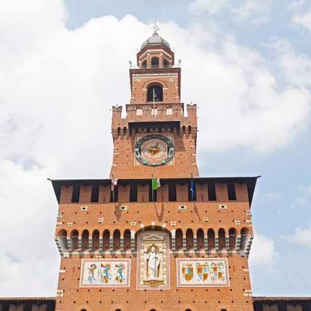 sforzesco: The Filarete Tower of the Castello Sforzesco in Milan, Italy. Historic clock and a coat of arms of the Visconti family on the wall of the tower.