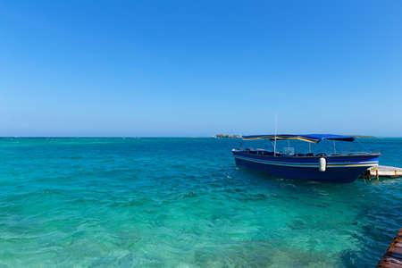 archipelago: Tourist motorboat near del Rosario Islands, Colombia. Del Rosario Islands archipelago known as coral islands. Stock Photo