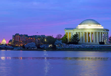us capitol: Colorful sunrise over Tidal Basin during cherry blossom festival in Washington DC, USA. Thomas Jefferson Memorial and US Capitol at dawn in spring. Editorial