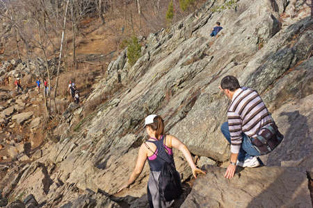 lower section: CARDEROCK, MARYLAND, USA  DECEMBER 13, 2015; Hikers keep their balance on a steep section of Billy Goat trail at Great Falls Park on December 13, 2015 in Carderock, Maryland. Hikers making their way to the lower section of the rocky Billy Goat trail in th