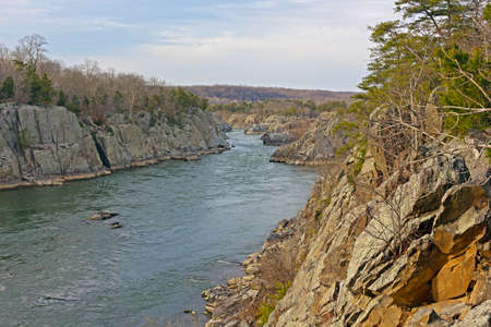 Potomac River at Great Falls Park in winter, Maryland, USA. Rock formations along Potomac River before sunset.