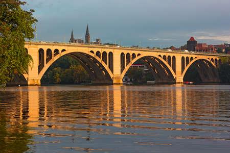 scott: Key Bridge at sunrise in Washington DC. Francis Scott Key Bridge and Georgetown skyline with reflections.
