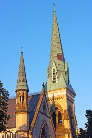 gothic revival: The Church of the Ascension and Saint Agnes in Washington DC, USA. The Gothic Revival brick structure of the historic Episcopal church building in US capital touched by sunset.