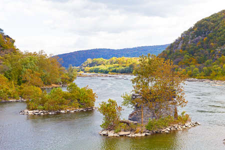 west river: Shenandoah River and Potomac River meet each other near Harpers Ferry historic town. Old bridge bearings in the water in autumn, Harpers Ferry, West Virginia.