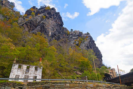 forest railroad: Harpers Ferry railroad tunnel and Appalachian Mountains, West Virginia, USA. Autumn in the mountains forest of West Virginia. Stock Photo