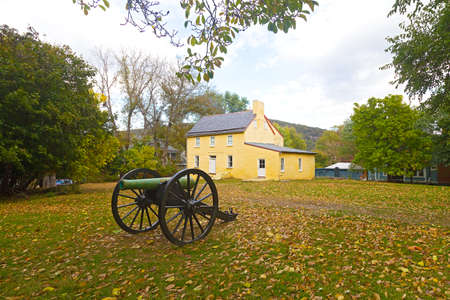 artifact: Historic battlefield cannon in Harpers Ferry, West Virginia, USA. Historic town in autumn with displayed old military artifact. Stock Photo