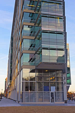 multistory: Modern building in Chinatown neighborhood of Washington DC. Multistory building from steel and glass at sunset.