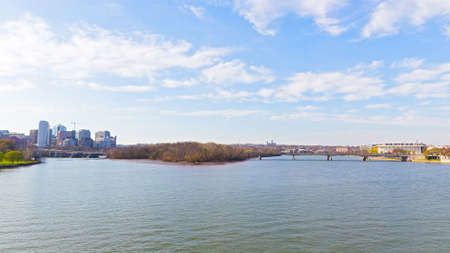 performing arts: Panoramic view over Potomac river in Washington DC. Rosslyn skyline, the Key Bridge and Kennedy Center for the Performing Arts in spring. Stock Photo