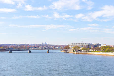 rosslyn: Panoramic view over Potomac river in Washington DC. The Key Bridge and Kennedy Center for the Performing Arts in spring.