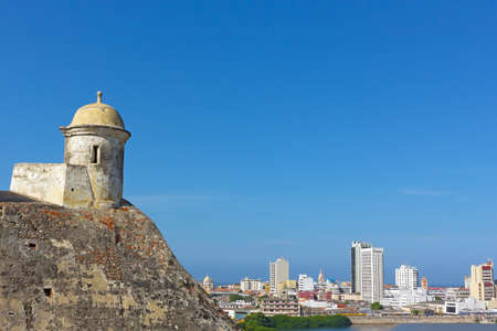 barajas: San Filipe de Barajas Castle tower and a view on Cartagena old city, Colombia. City panorama with Cartagena city landmarks in the morning.