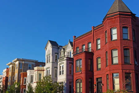 townhouses: Historic townhouses in Washington DC, USA. Row houses under evening sun in summer in US capital.