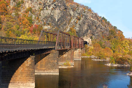 west river: Bridge on the Appalachian Trail where the Potomac River meets the Shenandoah River. Autumn landscape in Harpers Ferry, West Virginia, USA.
