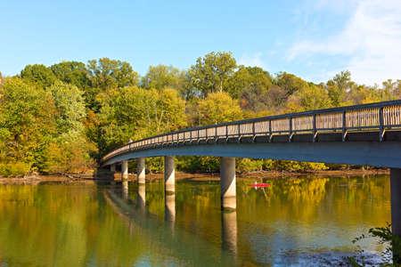 Footbridge bridge to the Theodore Roosevelt Island in Washington DC, USA. Kayaking on Potomac River in early autumn. Stock Photo