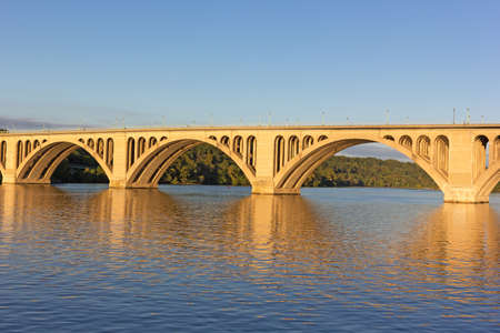A sunrise over Key Bridge in Washington DC. A view on Key Bridge over Potomac River from the District of Columbia, USA. Stock Photo