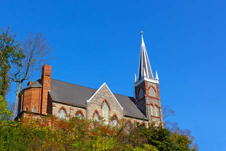 St. Peters Roman Catholic Church in Harpers Ferry, West Virginia, USA. Church building on the hill at autumn.