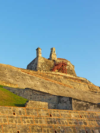 Bell and observation towers on top of San Felipe de Barajas fortress in Cartagena, Colombia. The bastion known for its extensive maze of underground tunnels played significant role in the region colonial past. Stock Photo