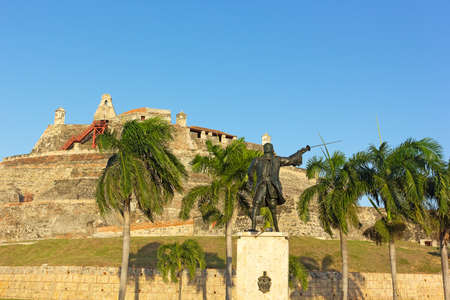 bastion: Statue of wounded General Blas in front of San Felipe de Barajas fortress at sunset. Legendary bastion is a landmark of Cartagena, Colombia. Editorial