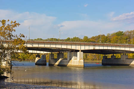 Theodore Roosevelt Memorial bridge in autumn, Washington DC. Potomac River provides opportunity for relaxation and recreation in urban settings.