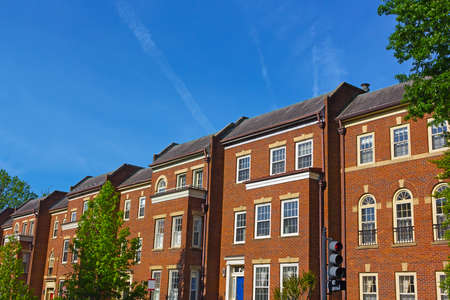 townhouses: Historic red brick townhouses in Georgetown neighborhood of Washington DC, USA. Historic urban architecture of US capital in spring. Stock Photo