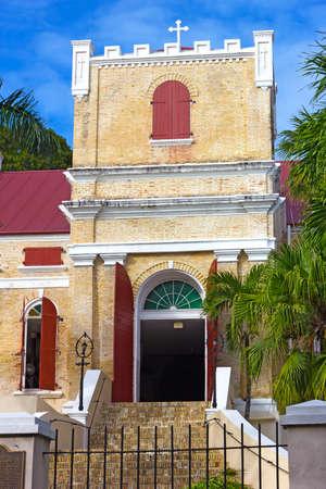 Lutheran Church on St Thomas Island, USVI. Seventeenth century church with ornate tower and palm trees.