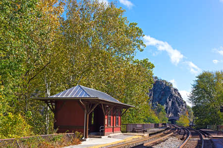 Harpers Ferry rail station platform, West Virginia. Railroad going to the tunnel on a sunny fall day.