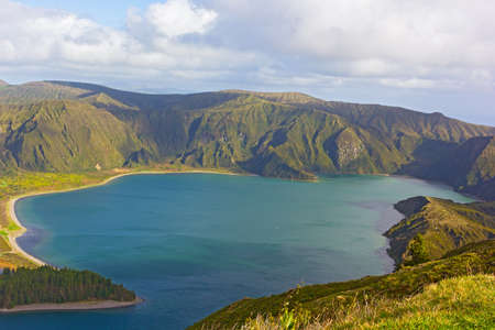 Volcanic lake at heights of the island surrounded by Nature Reserve, Azores, Portugal. A view of Lake Fogo when the sun came out.